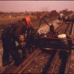 SOUTHERN_RAILWAY_RIGHT-OF-WAY_WORKER,_WORKING_WITH_A_MACHINE_THAT_AIDS_IN_REPLACING_OLD_TRACK_WITH_NEW_QUARTER_MILE..._-_NARA_-_556874.jpg